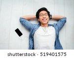 asian man in shirt on the floor.... | Shutterstock . vector #519401575