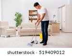 man cleaning home with broom | Shutterstock . vector #519409012
