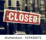 vintage looking closed sign in