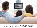 family watching tv on couch | Shutterstock . vector #519439486