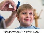 happy kid at hairdresser... | Shutterstock . vector #519444652
