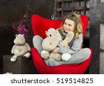 Smiling Young Girl Sitting With ...