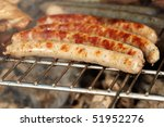 brats on the grill - stock photo