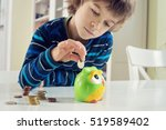 little boy playing with coins... | Shutterstock . vector #519589402