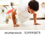 young man exercise in his house ... | Shutterstock . vector #519593875