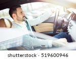 young businessman driving a car. | Shutterstock . vector #519600946
