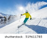 skier skiing downhill in high... | Shutterstock . vector #519611785