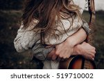 Man With Guitar Hugging His...