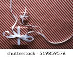 two gifts with white ribbon on... | Shutterstock . vector #519859576