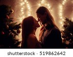 young couple kissing near... | Shutterstock . vector #519862642