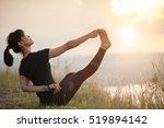 yoga woman mountain peak   | Shutterstock . vector #519894142