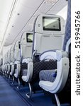 Small photo of Commercial aircraft cabin with rows of seats