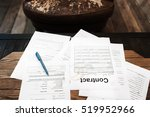 Small photo of Table of busy businessman with papers. Top view on old workplace of unsuccessful entrepreneur with stack of unsigned contracts. Crisis, failure, bankruptcy concept