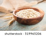 oat flakes in a bowl on a table ... | Shutterstock . vector #519965206