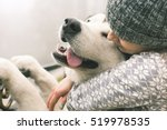 Stock photo image of young girl with her dog alaskan malamute outdoor 519978535