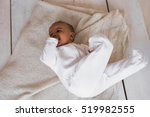 african american baby boy lying | Shutterstock . vector #519982555