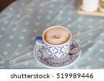 coffee cup on the wood texture... | Shutterstock . vector #519989446