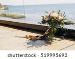 wedding bouquet lying on the... | Shutterstock . vector #519995692