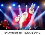 dj  santa claus mixing at the... | Shutterstock . vector #520011442