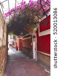 Small photo of Callejon Agua street in Seville Andalusia Sevilla of spain