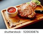 beautiful juicy pork steak... | Shutterstock . vector #520030876