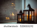christmas lanterns with candles.... | Shutterstock . vector #520033192