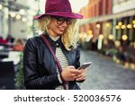 woman texting on her smartphone | Shutterstock . vector #520036576