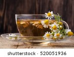 cup of medicinal chamomile tea... | Shutterstock . vector #520051936