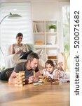 cheerful family at home  daddy... | Shutterstock . vector #520071682