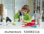 little boy being creative... | Shutterstock . vector #520082116