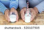 senior couple holding milk in... | Shutterstock . vector #520107505