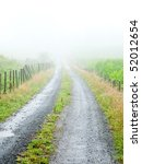 Dirt road on a foggy day - stock photo