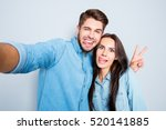 funny couple showing tongues... | Shutterstock . vector #520141885