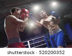 boxers fighting in a boxing ring | Shutterstock . vector #520200352