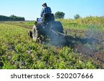 Farmer On Tractor Plowing