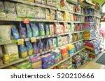 Stock photo packs of animal food on pet shop shelves 520210666