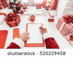 Santa Claus Working At Desk And ...