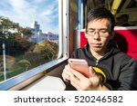 young tourist man using on the... | Shutterstock . vector #520246582