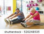 senior couple exercising in gym    Shutterstock . vector #520248535