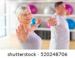 senior couple exercising in gym  | Shutterstock . vector #520248706