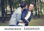 gay couple love outdoors concept | Shutterstock . vector #520249225