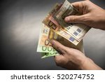 man hand with euro isolated on... | Shutterstock . vector #520274752
