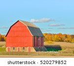 Red Barn Set Against Autumn...