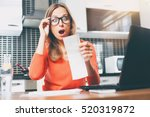 stressed over bills. portrait... | Shutterstock . vector #520319872