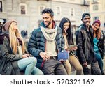 Small photo of Group of multi-ethnic friends walking on the streets and smiling - Young people having fun outdoors