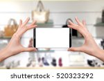 female holding a smartphone... | Shutterstock . vector #520323292