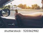 man holding beer bottle while... | Shutterstock . vector #520362982