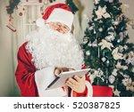 Portrait Of Happy Santa Claus...