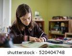 girl doing homework  | Shutterstock . vector #520404748