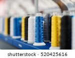 wool and thread spools on desk... | Shutterstock . vector #520425616